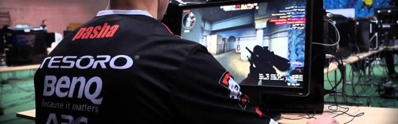 Male playing CSGO competitively at a LAN